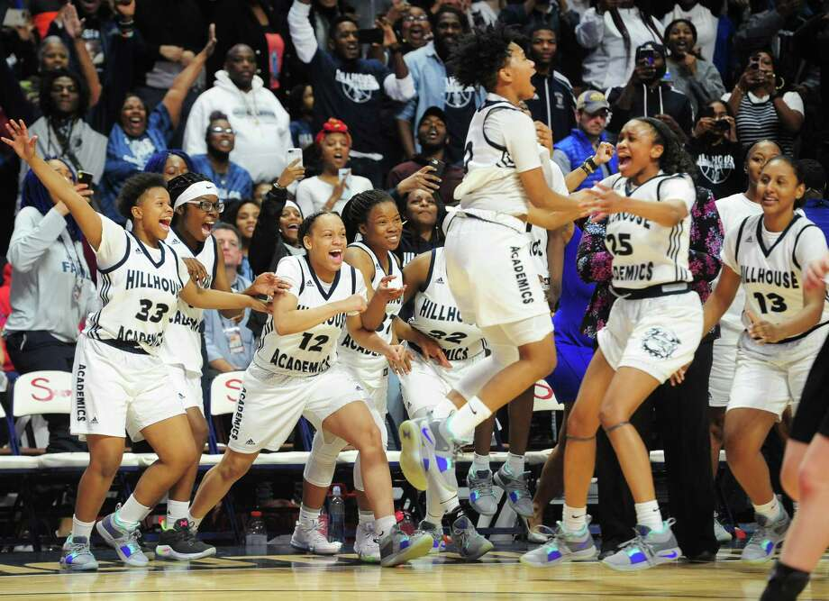 The Hillhouse girls celebrate the Class L state championship victory over Hand on Saturday at Mohegan Sun Arena. Photo: Christian Abraham / Hearst Connecticut Media / Connecticut Post