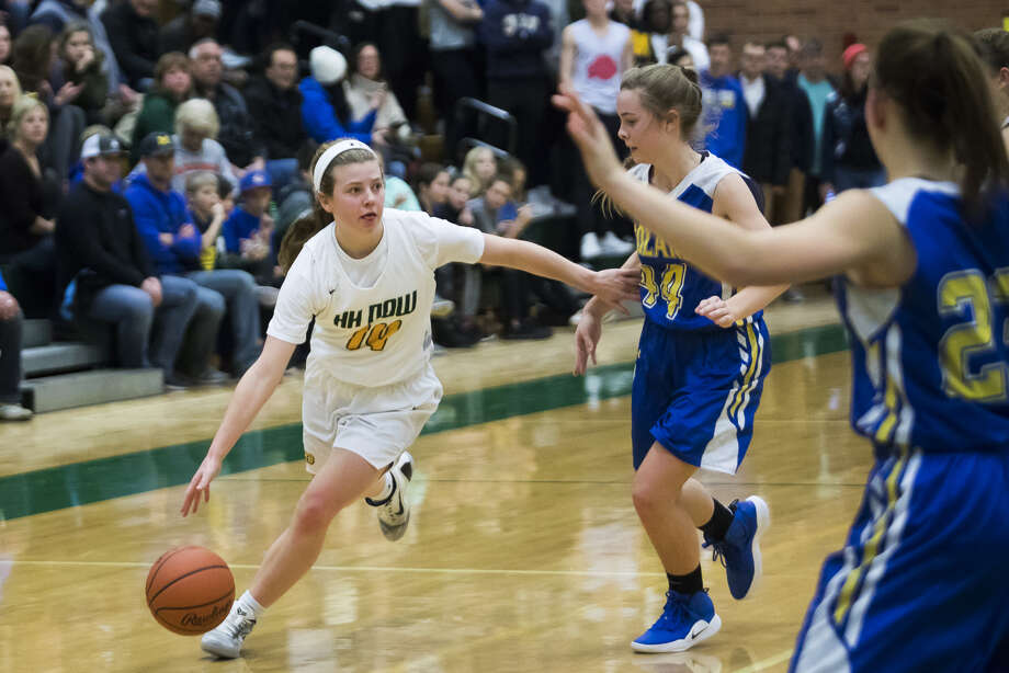 Dow High's Molly Davis looks for a driving lane during a Jan. 25, 2019 game against Midland High. Photo: Daily News File Photo