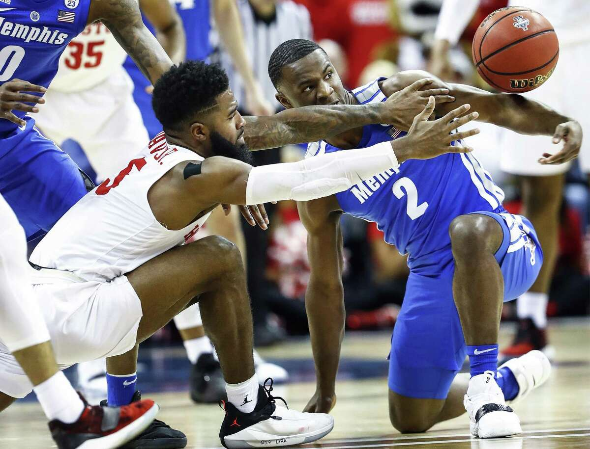 PHOTOS: Former Houston high school stars in the 2019 NCAA Tournament Memphis defender Alex Lomax (right) battles Houston guard Corey Davis Jr. (left) for a loose ball during action in their semifinal round AAC Tournament game at the FedExForum, Saturday, March 16, 2019. >>>See former Houston high school basketball stars who will be playing in the 2019 NCAA Tournament ...