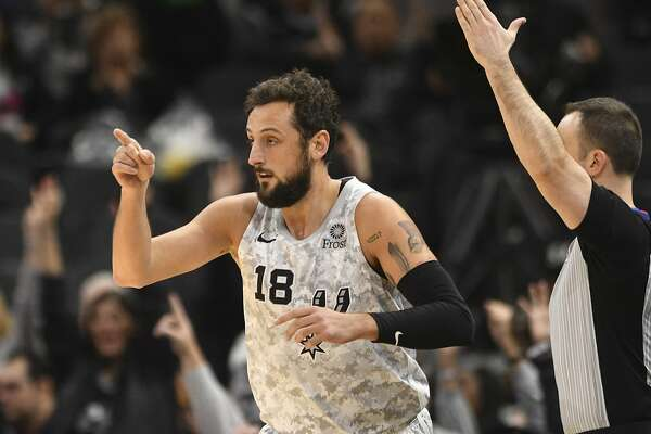 Marco Belinelli of the San Antonio Spurs gestures to teammate Patty Mills after scoring on a three-point shot during NBA action in the AT&T Center on Saturday, March 16, 2019. Mills had an assist on the play.