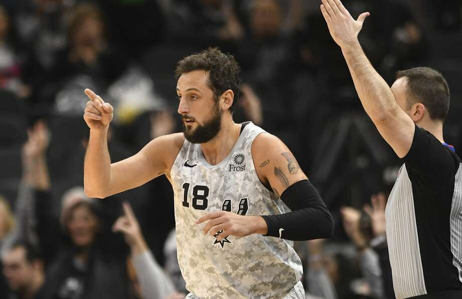 Marco Belinelli of the San Antonio Spurs gestures to teammate Patty Mills after scoring on a three-point shot during NBA action in the AT&T Center on Saturday, March 16, 2019. Mills had an assist on the play. Photo: Billy Calzada, Staff Photographer