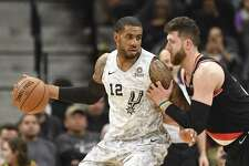 LaMarcus Aldridge (12) of the San Antonio Spurs works against Jusuf Nurkic of the Portland Trail Blazers during NBA action in the AT&T Center on Saturday, March 16, 2019.