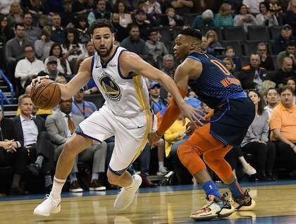 96fa81f8eb33 Oklahoma City Thunder guard Russell Westbrook (0) defends against Golden  State Warriors guard Klay Thompson (11) during the first half of an NBA  basketball ...