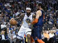 Oklahoma City Thunder center Steven Adams (12) defends against Golden State Warriors center DeMarcus Cousins (0) during the first half of an NBA basketball game Saturday, March 16, 2019, in Oklahoma City. (AP Photo/June Frantz Hunt)