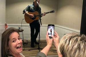 Brad Paisley showed up at Blue Door Coffee Company in The Woodlands for an impromptu concert.