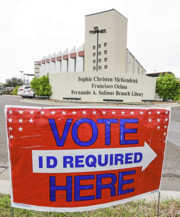 A voting sign is setup outside the Sophie Christen McKendrick Francisco Ochoa Fernando A. Salinas Branch Library on Monday, Dec. 3, 2018, as early voting begins for run-off elections. The branch library is one of five permanent early voting sites. Photo: Danny Zaragoza, Staff Photographer / Laredo Morning Times