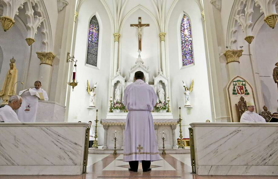 Jose Guadalupe Cadena stands before the altar Saturday morning at San Agustin Catholic Cathedral. Photo: Staff Photo /Laredo Morning Times / LAREDO MORNING TIMES