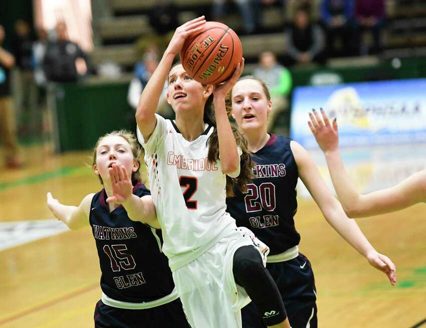 CambridgeOs Sophie Phillips (2) scores in front of Watkins GlenOs Aislinn Klemann (15) and Adrienna Solomon (20) in the New York State Public High School Athletic Association girls' Class C championship basketball game Saturday, March 16, 2019, in Troy, N.Y. Cambridge won 57-43. (Hans Pennink / Special to the Times Union)