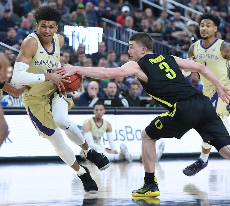 Oregon's Payton Pritchard tries to strip the ball from Washington's Matisse Thybulle during the Pac-12 tournament championship game in Las Vegas. Photo: Ethan Miller / Getty Images