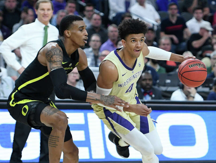 LAS VEGAS, NEVADA - MARCH 16:  Matisse Thybulle #4 of the Washington Huskies drives against Kenny Wooten #14 of the Oregon Ducks during the championship game of the Pac-12 basketball tournament at T-Mobile Arena on March 16, 2019 in Las Vegas, Nevada.  (Photo by Ethan Miller/Getty Images) Photo: Ethan Miller/Getty Images / 2019 Getty Images