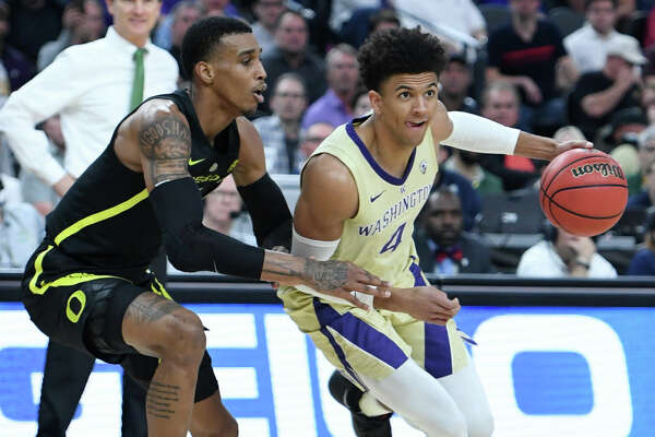 LAS VEGAS, NEVADA - MARCH 16: Matisse Thybulle #4 of the Washington Huskies drives against Kenny Wooten #14 of the Oregon Ducks during the championship game of the Pac-12 basketball tournament at T-Mobile Arena on March 16, 2019 in Las Vegas, Nevada. (Photo by Ethan Miller/Getty Images)