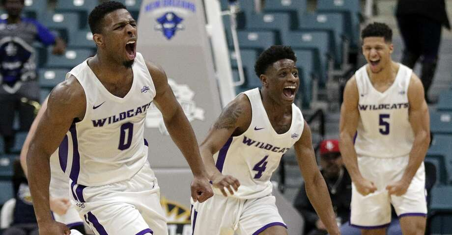 Abilene Christian guard Jaylen Franklin (0), guard Damien Daniels (4) and guard Payten Ricks (5) celebrate the team's lead in the final minute of an NCAA college basketball game against New Orleans for the Southland Conference men's tournament title Saturday, March 16, 2019, in Katy, Texas. (AP Photo/Michael Wyke) Photo: Michael Wyke/Associated Press