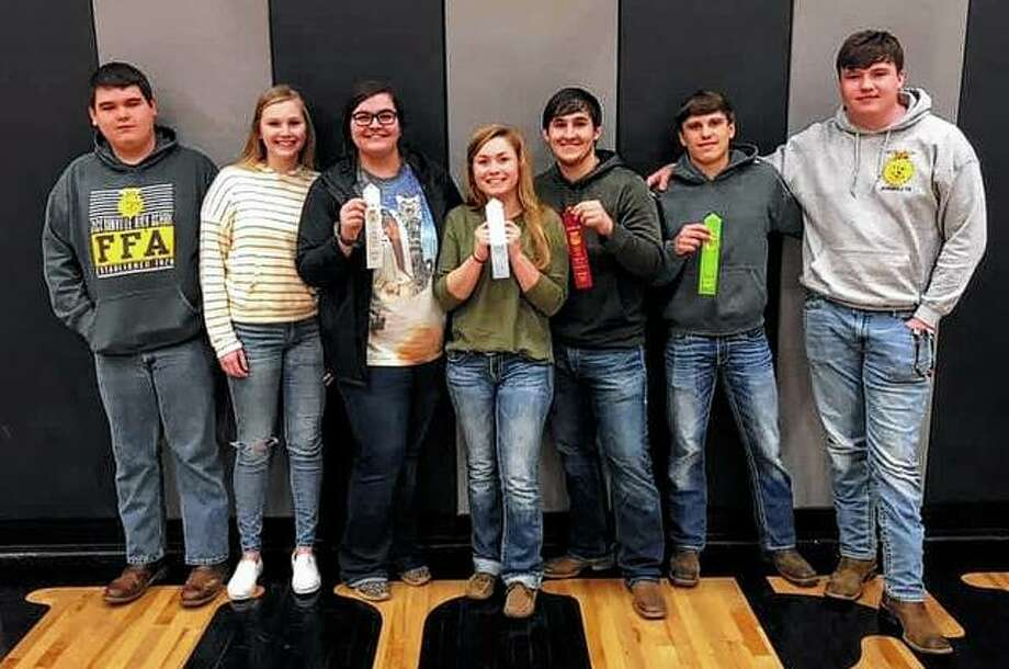 Jacksonville FFA's poultry team placed third in the Section contest on Feb. 26 in Bluffs. Varsity team members include Garrett Bruns (from left), Katie White, Allison Wheeler, Skylar Bartz and Blake Hadden. Hadden finished second overall and Bartz finished 10th. The greenhand team placed sixth and included Tyler Christian (second from right) and Myles Homann. The poultry team is coached by Phil Bartz. Photo: Photo Provided