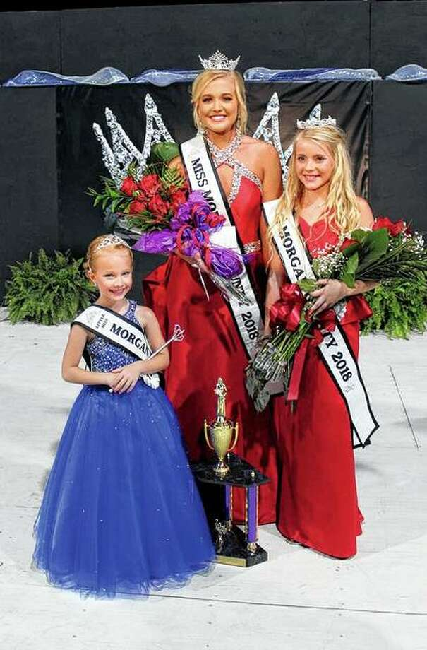 Savanna Long (center), 2018 Miss Morgan County; Bella Evans (right), 2018 Junior Miss Morgan County; and Chloe Buhlig, 2018 Morgan County Princess, won their respective titles during pageants that were part of the 2018 Morgan County Fair. Photo: Photo Provided