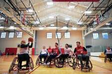 Participants play a game of wheelchair basketball during Adaptapalooza at Illinois State University's Student Fitness Center in Normal.