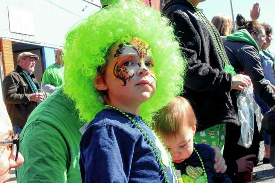 Silas Bendorf is decked out in green and ready for the start of the St. Patrick's Day Parade in downtown Jacksonville on Saturday. The parade is in its 30th year. Photo: Rosalind Essig | Journal-Courier