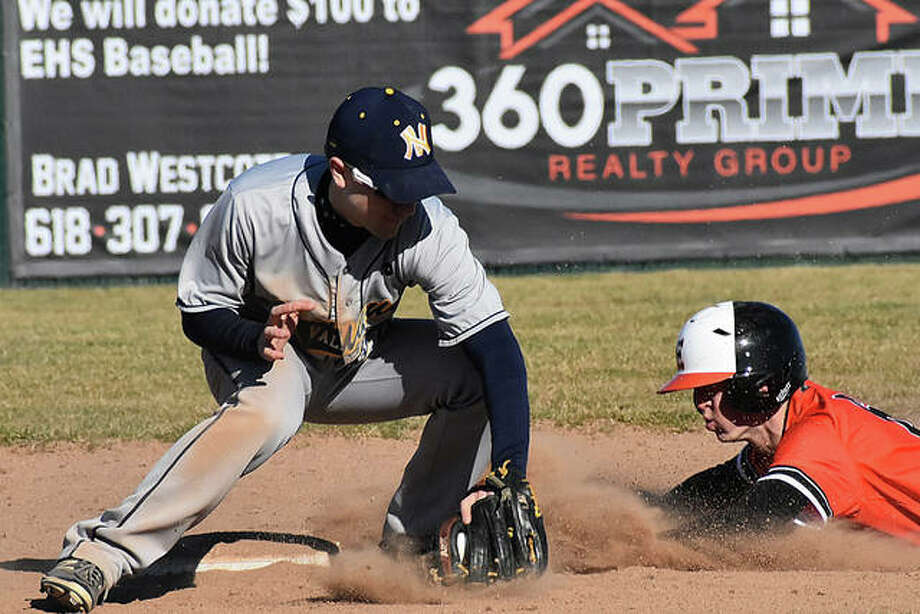 Edwardsville's Hayden Moore slides safely into second base with a stolen base in the first inning against Neuqua Valley. Photo: Matt Kamp/Intelligencer