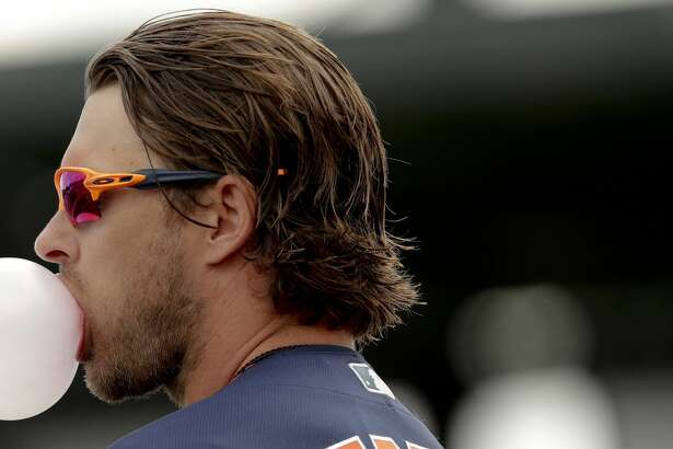 Houston Astros' Josh Reddick (22) blows a bubble before an exhibition spring training baseball game against the St. Louis Cardinals on Saturday, March 9, 2019, in Jupiter, Fla. (AP Photo/Brynn Anderson)