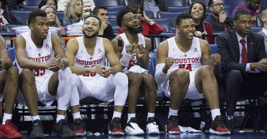 Houston players, from left, Fabian White Jr., Galen Robinson, Corey Davis Jr. and Breaon Brady celebrate a huge lead over Connecticut in the second half of an NCAA college basketball game at the American Athletic Conference tournament Friday, March 15, 2019, in Memphis, Tenn. (AP Photo/Troy Glasgow) Photo: Troy Glasgow/Associated Press