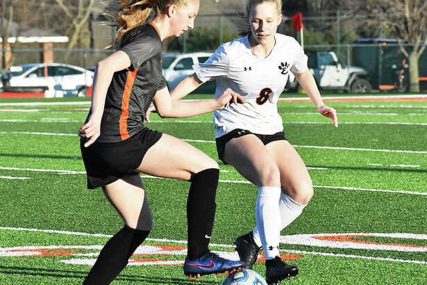 Edwardsville's Sarah Kraus, right, plays defense during first-half action against Waterloo on Saturday inside the District 7 Sports Complex.