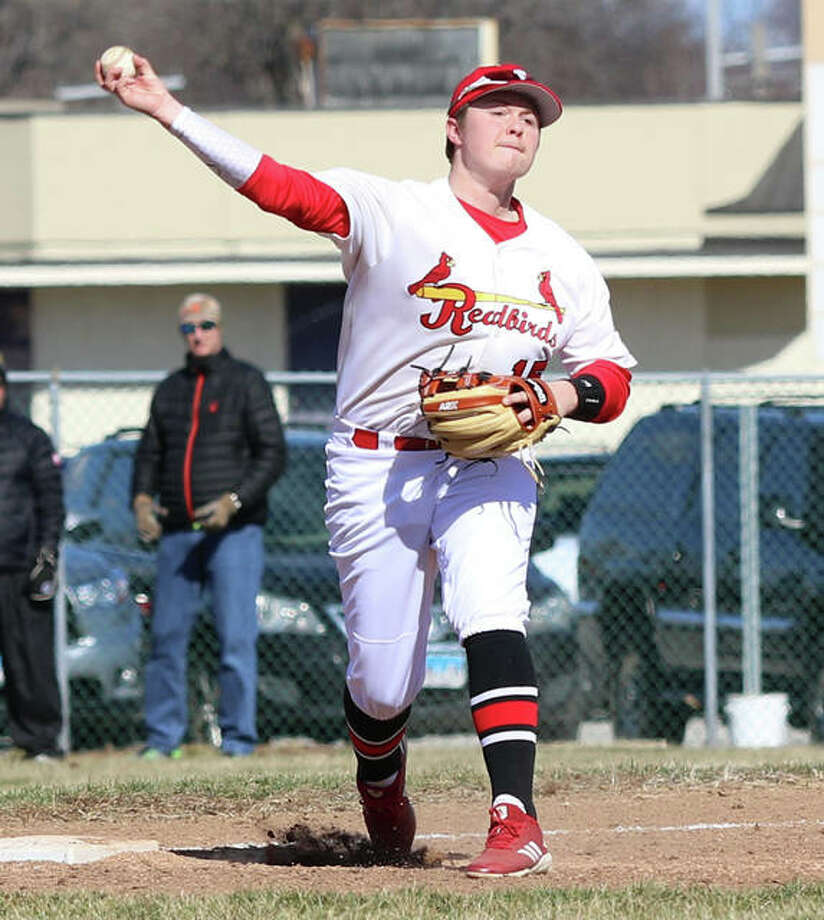 Alton third baseman Adam Stilts makes a throw to first during Friday's PBR Kickoff Classic game against Lockport in Granite City. The Redbirds opened at home Saturday morning and defeated Coal City. Photo: Greg Shashack / The Telegraph