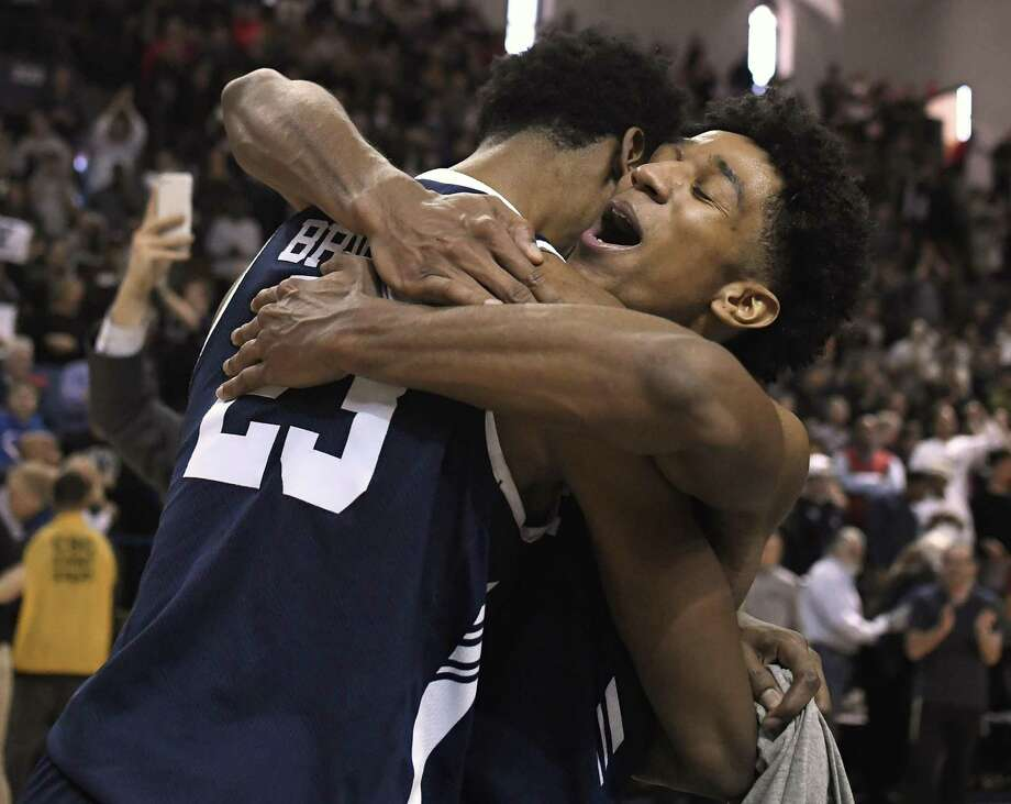 Yale's Trey Phills, right, celebrates with teammate Jordan Bruner, left, after their Ivy League championship win over Harvard Sunday. Photo: Jessica Hill / Associated Press / Copyright 2019 The Associated Press. All rights reserved