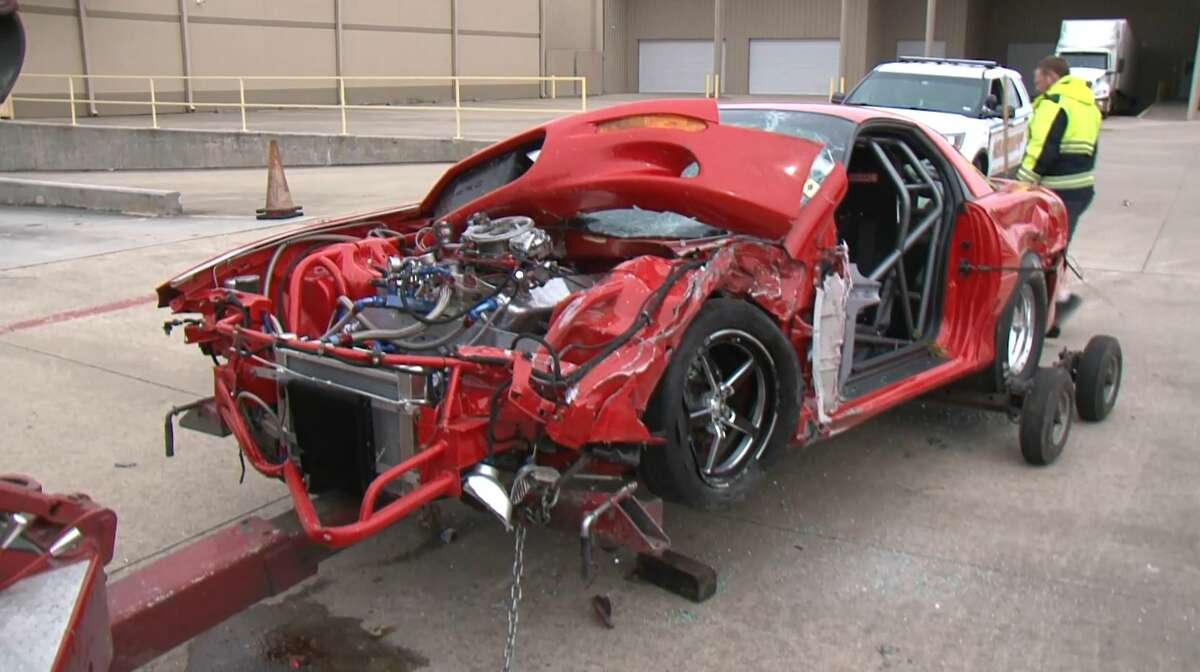 The remains of a street racer are hauled off after the driver allegedly crashed into onlookers, severely injuring two people March 17, 2019.