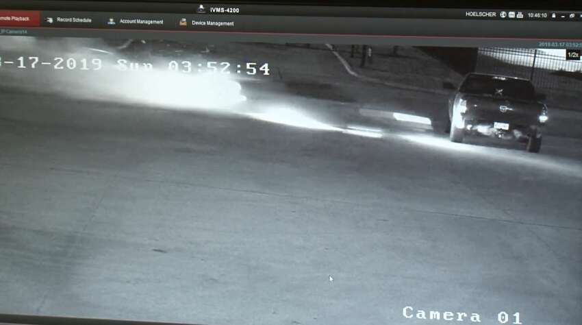 Surveillance video shows the moment before a street racer crashes into a parked pickup truck March 17, 2019.