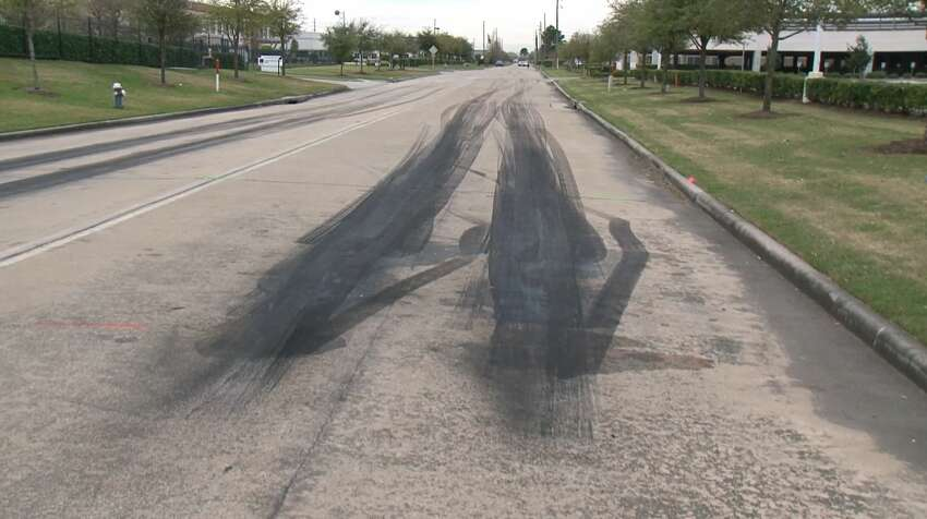 Skidmarks are seen on a roadway after a driver allegedly crashed into onlookers, severely injuring two people March 17, 2019.