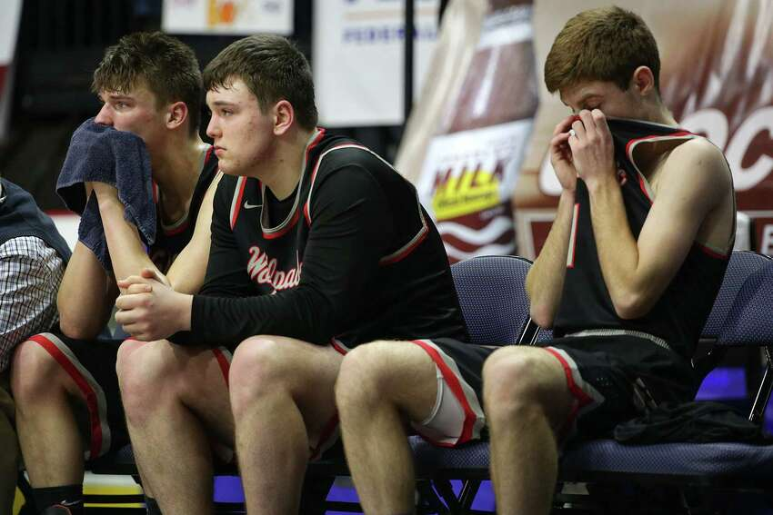 Oppenheim-Ephratah/St. Johnsville players react after their Class D final loss to Harrisville on Sunday in Binghamton. (Erin Reid Coker/Special to the Times Union)