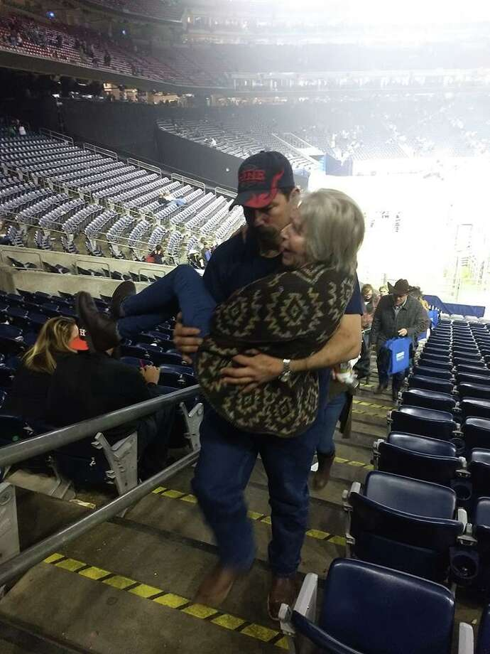 Volunteer firefighter carries struggling grandmother to her seat at RodeoHouston