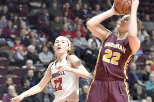 Uncasville, Connecticut- Sunday, March 17, 2019: Jessica DeliaRatta of Cromwell H.S., left, defends against a shot by Olivia Robles of Sheehan H.S. of Wallingford, right, during the second quarter of the CIAC 2019 State Girls Basketball Tournament Class M championship final Sunday afternoon at Mohegan Sun in Uncasville.