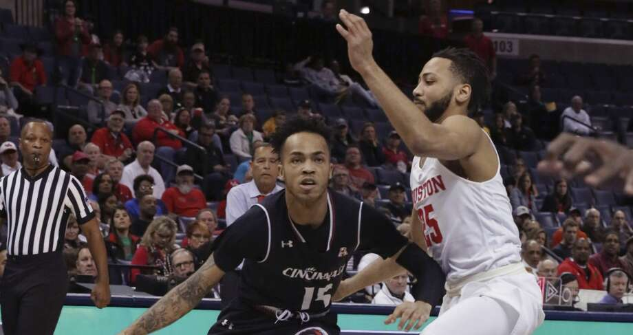 Cincinnati's Cane Broome drive the ball past Houston's Galen Robinson during the first half of an NCAA college basketball for the American Athletic Conference men's tournament championship Sunday, March 17, 2019, in Memphis, Tenn. (AP Photo/Troy Glasgow) Photo: Troy Glasgow/Associated Press