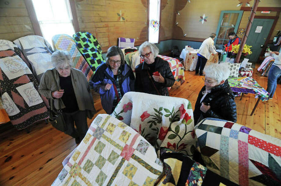 Visitors gaze over quilts Saturday during the 2019 Quilt Expo Elsah. Quilts were displayed throughour a 12-stop tour for the event.
