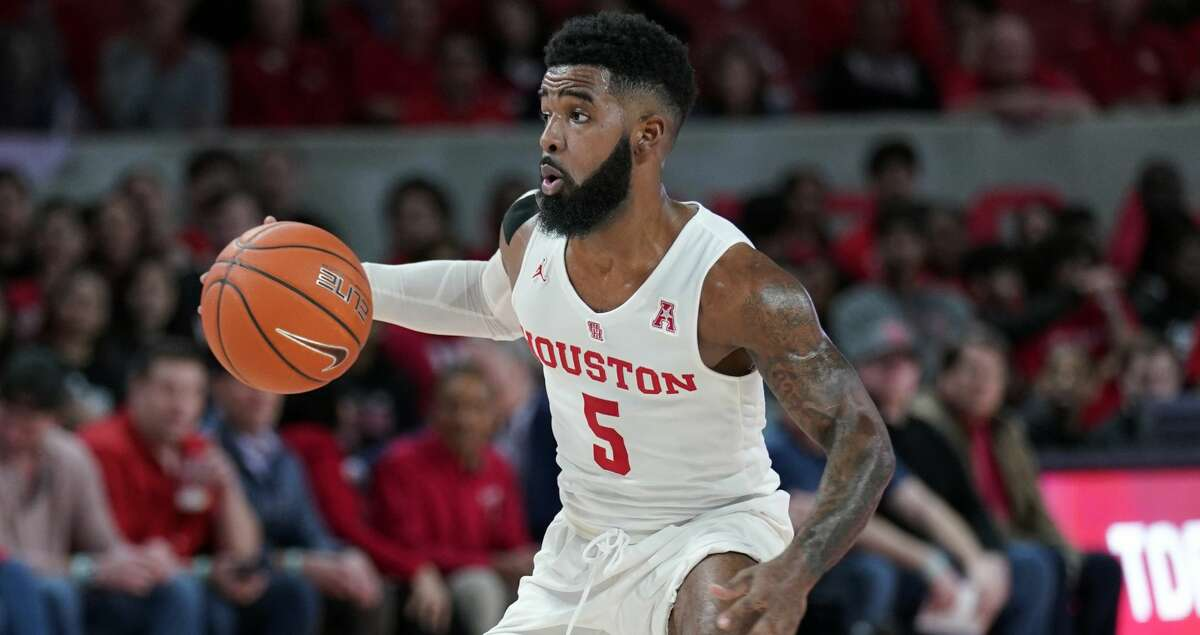 Houston's Corey Davis Jr. (5) brings the ball up court against SMU during the first half of an NCAA college basketball game Thursday, March 7, 2019, in Houston. (AP Photo/David J. Phillip)