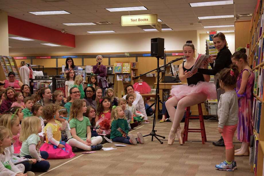 Isabel Brenner, 13, of Fairfield, reads the story to kids at the ballet story time at Fairfield University Bookstore on Friday, March 15, 2019, in Fairfield, Conn. Photo: Jarret Liotta / For Hearst Connecticut Media / Fairfield Citizen News Freelance