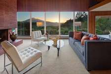 Looking very much as it must have when built in 1950, this San Rafael mid-century offers a commanding Mt. Tam view and a ton of history
