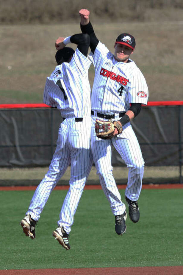SIUE shortstop Jordan Ross (1) and second baseman Garrett Carmichael celebrate after the final out of the Cougars' 3-2 OVC baseball victory over Southeast Missouri on Sunday at the Simmons Baseball Complex in Edwardsville. Photo: Greg Shashack / The Telegraph