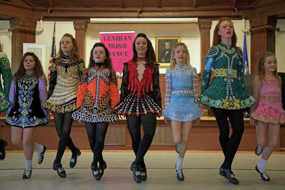 A row of colorful costumes at the performance of the Lenihan Irish Dancers at Pequot Library on Saturday, March 16, 2019, in Fairfield, Conn. Photo: Jarret Liotta / For Hearst Connecticut Media / Fairfield Citizen News Freelance