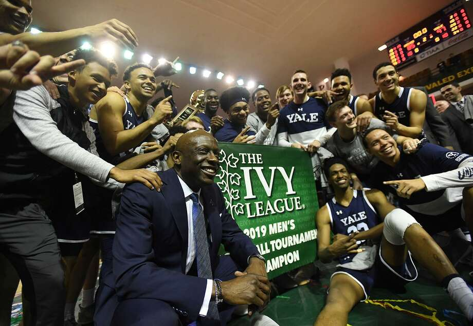 Members of Yale men's basketball team celebrate after their win over Harvard in the Ivy League championship game on Sunday. Photo: Brian A. Pounds / Hearst Connecticut Media / Connecticut Post