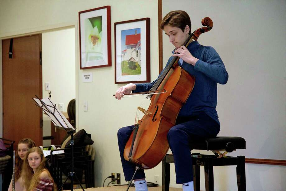Sam Powell, 15, plays Bach at a performance by the Tri-M Music Honor Society at the Westport Center for Senior Activities on Saturday, March 16, 2019, in Westport, Conn. Photo: Jarret Liotta / For Hearst Connecticut Media / Westport News Freelance