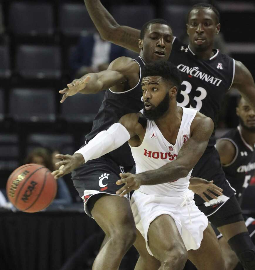 Cincinnati's Keith Williams and Nysier Brooks (33) defend against Houston's Corey Davis Jr. during the first half of the NCAA college basketball game for the American Athletic Conference men's tournament championship Sunday, March 17, 2019, in Memphis, Tenn. (AP Photo/Troy Glasgow) Photo: Troy Glasgow, FRE / Associated Press / Copyright 2019 The Associated Press. All rights reserved