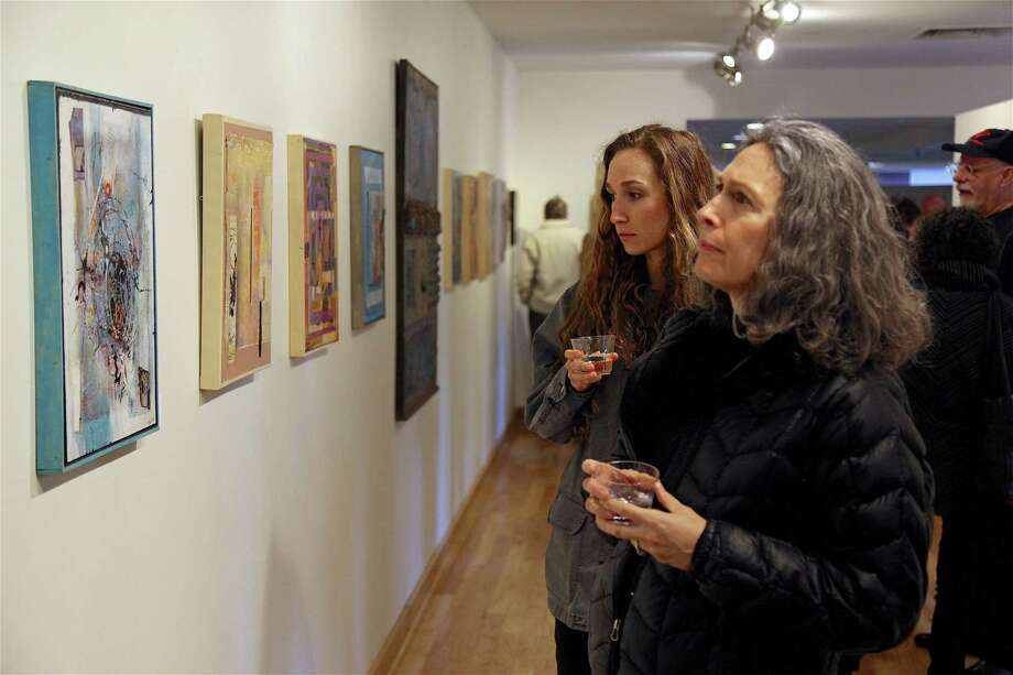 "Sara Reszutek and her mother, Lori, of Fairfield, discuss the work at the ""Emergence"" show's opening reception at Fairfield Library on Saturday, March 16, 2019, in Fairfield, Conn. Photo: Jarret Liotta / For Hearst Connecticut Media / Fairfield Citizen News Freelance"