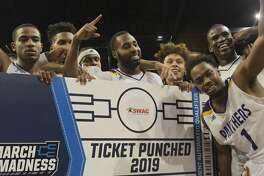 Prairie View A&M celebrates their 92-86 win over Texas Southern to take the SWAC NCAA college basketball championship Saturday, March 16, 2019, in Birmingham, Ala. (AP Photo/Julie Bennett)