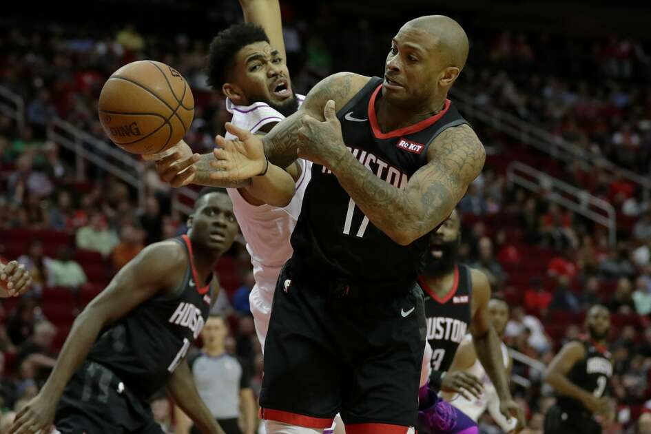 Houston Rockets forward PJ Tucker (17) gets the ball away from Minnesota Timberwolves center Karl-Anthony Towns (32) during the fourth quarter of an NBA basketball game at the Toyota Center on Sunday, March 17, 2019, in Houston.