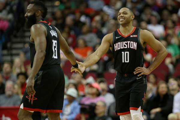 Houston Rockets guard James Harden (13) and guard Eric Gordon (10) celebrate during the third quarter of an NBA basketball game at the Toyota Center on Sunday, March 17, 2019, in Houston.