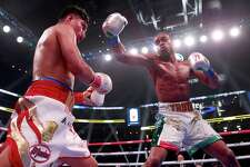 Errol Spence Jr., right, defeated Mikey Garcia, left, to retain his IBF world welterweight title Saturday in Dallas.