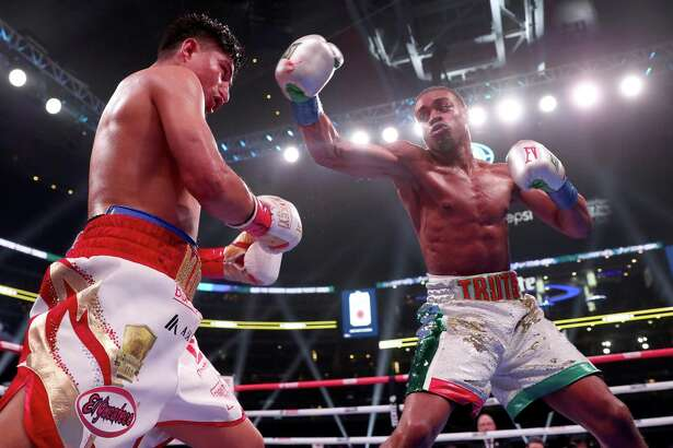 ARLINGTON, TEXAS - MARCH 16: (R-L) Errol Spence Jr fights Mikey Garcia in an IBF World Welterweight Championship bout at AT&T Stadium on March 16, 2019 in Arlington, Texas. (Photo by Tom Pennington/Getty Images)