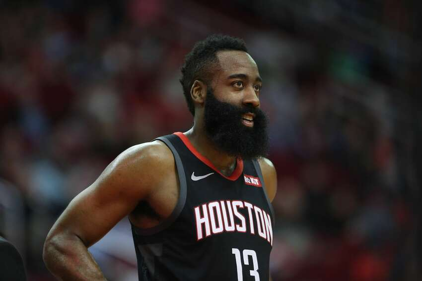 Houston Rockets guard James Harden (13) rests during a break in play during the third quarter of an NBA basketball game at the Toyota Center on Sunday, March 17, 2019, in Houston.