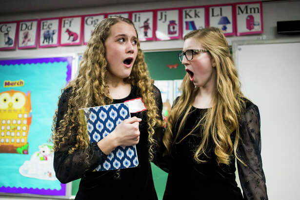 """Calvary Baptist Academy students Elaiyna Schwartzkopf, left, and Faith Howell, right, perform a scene from """"The Importance of Being Earnest"""" by Oscar Wilde during the Michigan Association of Christian Schools Fine Arts Festival on Friday, March 15, 2019 at Calvary Baptist. (Katy Kildee/kkildee@mdn.net)"""